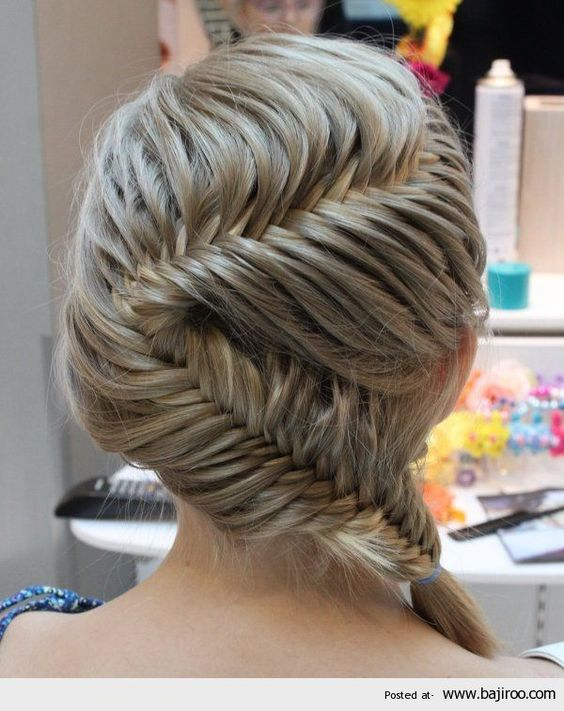 this isn't really wedding like hair but the braid is so neat!  Had to share with you