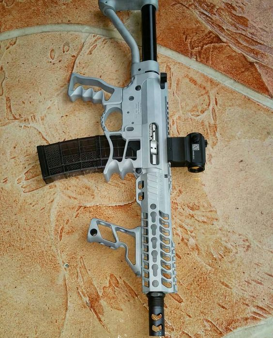 Skeletonized AR-15. Ridiculously light, and with the lightest rifle ammo for long travel times its perfect