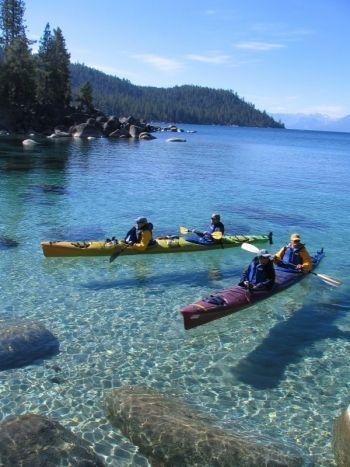 Kayaking the crystal clear waters of Lake Tahoe's east shore. Lake Tahoe borders both California and Nevada.
