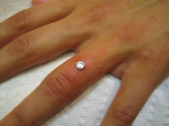 Finger Dermal peircing....If only I didnt use my hand so much beauty