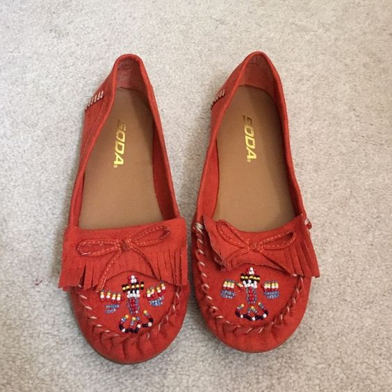 Orange moccasins Orange moccasins with beading. Used and in good condition Shoes Moccasins