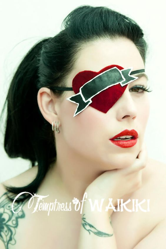 Red velvet tattoo style eye patch, featuring a red velvet heart with black leather scroll. This can be sold as seen or you can have your choice of words.