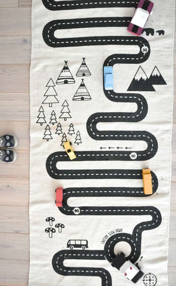 Adventure rug. Use a blank rug and paint or marker roads, parking lots and more