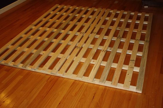 This is how I made a low-profile bed frame cheaply from wood slats. We want our mattress low to the ground so if our daughter ever falls out of bed, she doesn't have far to go
