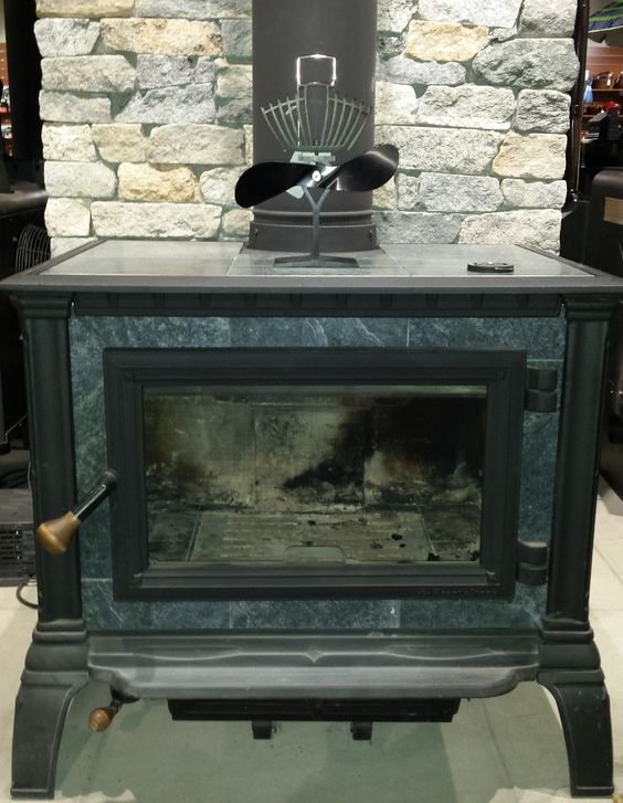 Eco Fan on the Hearthstone Equinox:  For use on freestanding wood stoves with a surface temperature between 150°F — 650°F (65°C — 345°C). The Ecofan UltrAir is an economical way to move air throughout your living space. Creating its own electricity and pushing up to 105 CFM (cubic feet per minute), this fan is ideal for those living off the grid or looking to increase the efficiency of their stove and use less fuel. Whisper quiet and completely assembled these fans make for a great gift.