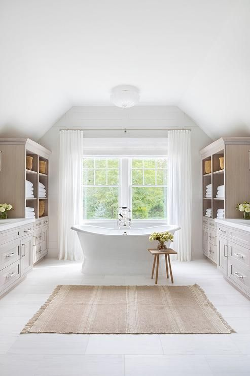 A French Burlap Bath Mat Sits In Front Of A Vintage Roll Top Bathtub Matched With A Chrome Tub Filler And A Wo In 2020 Bathroom Interior Bathroom Design House Interior