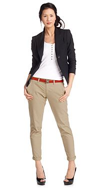 White baby doll t-shirt, skinny khaki's, navy blue cardigan, brown belt and mary janes.