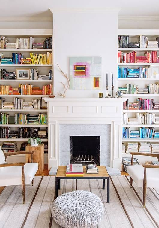 color coordinated bookshelves.