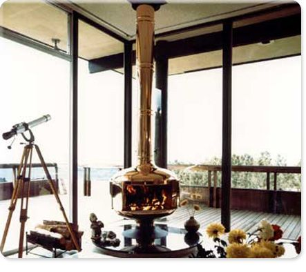 Malm Free Standing Fireplace Floor To Ceiling Glass And A Deck Overlooking The Water Gorgeous
