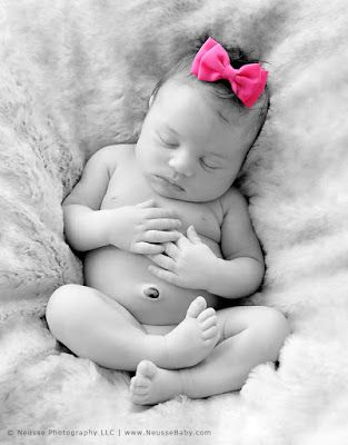 Fine Art Black and White Newborn baby girl Emma sleeping soundly with her pink headpiece, image by Neusse Photography LLC best baby photographer in Lehigh Valley Allentown Pennsylvania