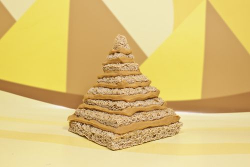 Peanut Butter Pyramid: Smooth Operator peanut butter layered between squares of bread constructed in a pyramidal fashion.