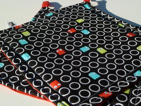 Pac Man Hot Pads / READY TO SHIP / Retro Kitchen Decor / Set of 2 / Video Game Fabric / Geek Gamer. $20.00, via Etsy.