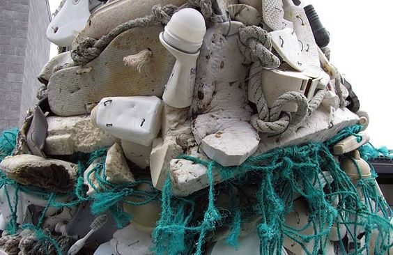 A close-up look at the pieces of ocean litter, including a sandal, toothbrush and deodorant stick, used to construct Lidea the seal