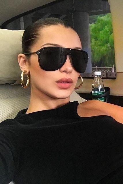 9903994055 Bella Hadid wearing Jennifer Fisher Baby Samira Hoop Earrings in Gold