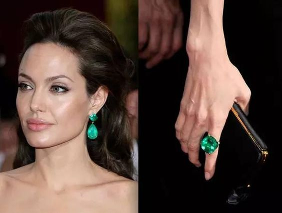 Angelina Jolie in emerald-drop earrings by Lorraine Schwartz