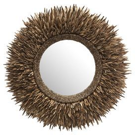 """Wall mirror with a metal and coconut shell frame.  Product: MirrorConstruction Material: Coco sticks, mirrored glass, metal, and plywoodColor: BrownDimensions: 29.5"""" Diameter"""