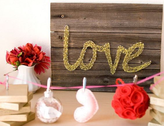 Decorative Mural. It's fantastic to decorate your wedding reception with this stunning love board mural. Cut a love word and post on the board, lock in a nail with two sides, remove the word and use colorful rope as you like to wrap around the nails.