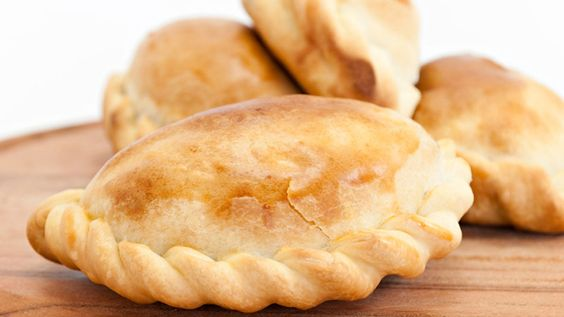 Pineapple Cajeta Empanadas-- just like Hector, my first host-dad in Guatemala, would make for us. He made them in his walk-in clay oven. He must have started baking at 4 AM because these treats were always done just in time for the walk to school :)