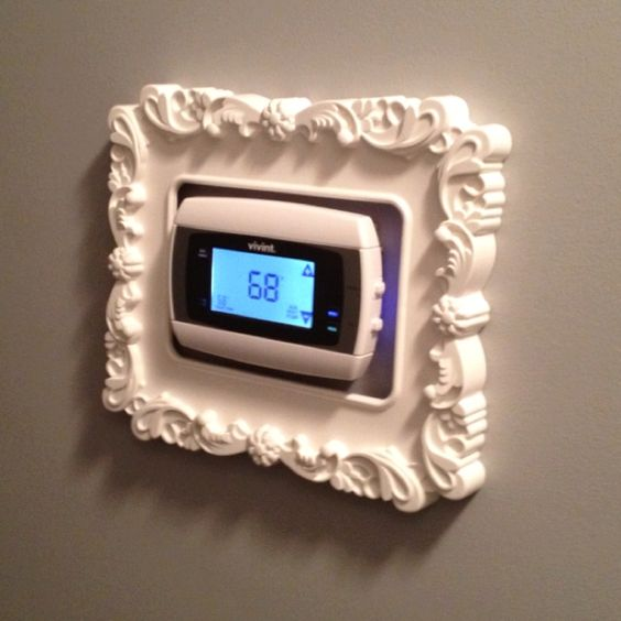 framed thermostat...$5 Ikea frame!  I don't think I will use such an ornate frame, but will definitely DO.