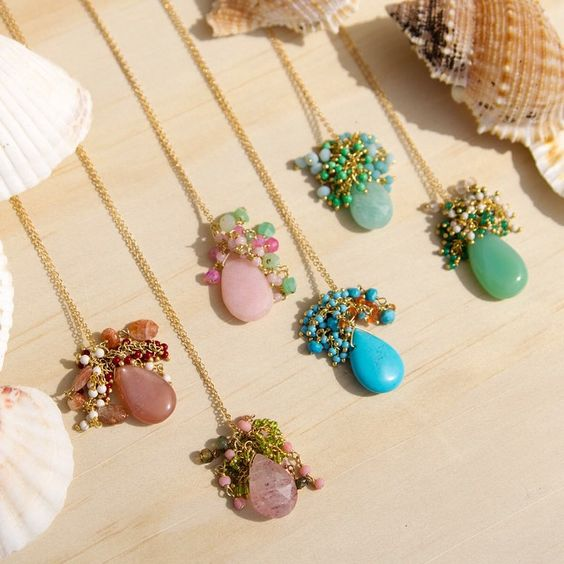 In need of some sun, beach, and our Ramayana Cluster Necklaces! #beachtones #jewelry #gems #summer #rafia www.rafiajewelry.com