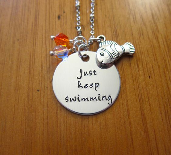 """Disney's Finding Nemo Inspired Necklace. Dory quote """"just keep swimming"""" by WithLoveFromOC, $21.00 & free shipping. Swarovski Crystals and a Clown fish charm."""