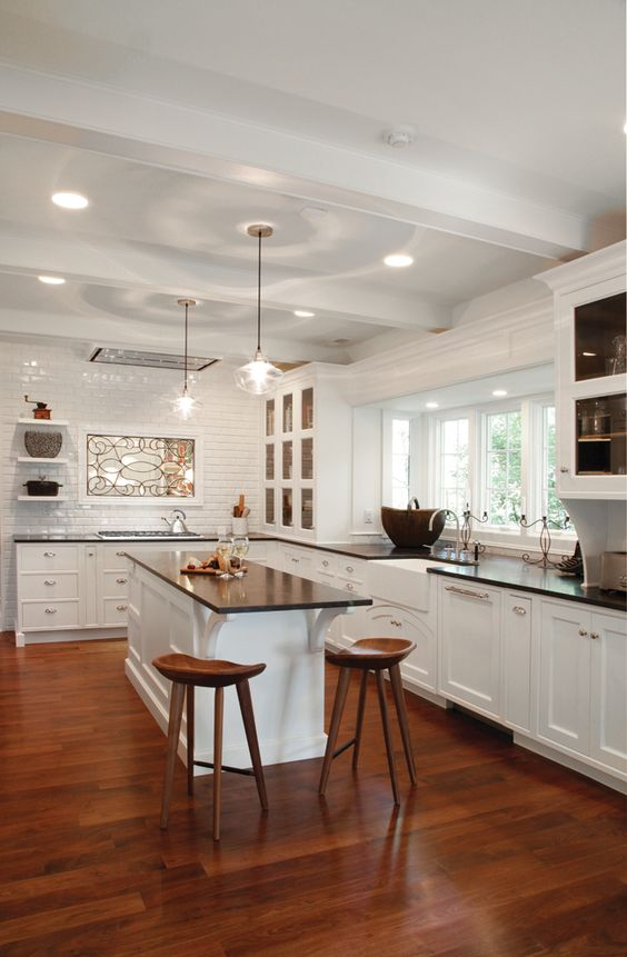White Kitchen Cabinets Contribute To A Neutral Color Palette In This Faralli Kitchen Kitchens