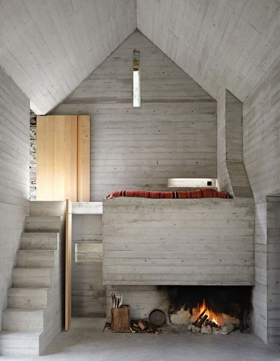 Modern, minimalist small country dwelling with cozy fireplace and lots of wood paneling: