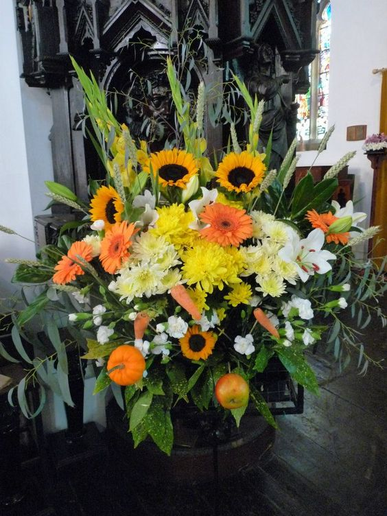 Harvest festival flower arrangement in church with