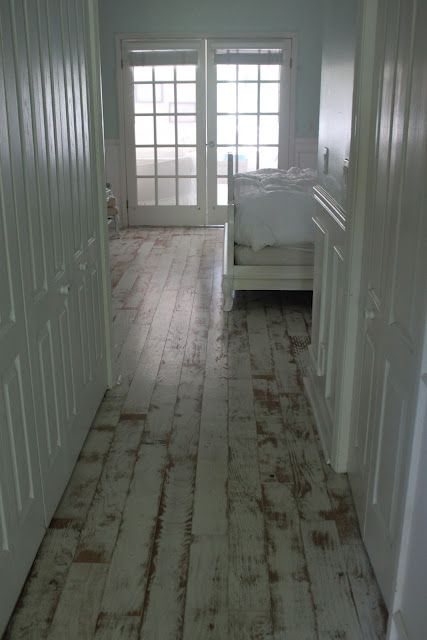 Painted wood floors they look good even when distressed for Painted wood floor ideas