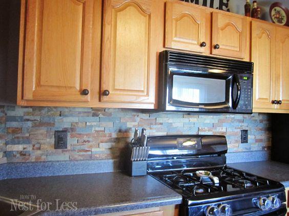 Stone kitchen backsplash oak cabinets butcher blocks for Alternative kitchen backsplash ideas