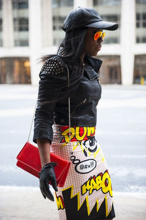 Style kaboom! This is what happens when a comic-inspired tube skirt partners up with some sleek leather goods.