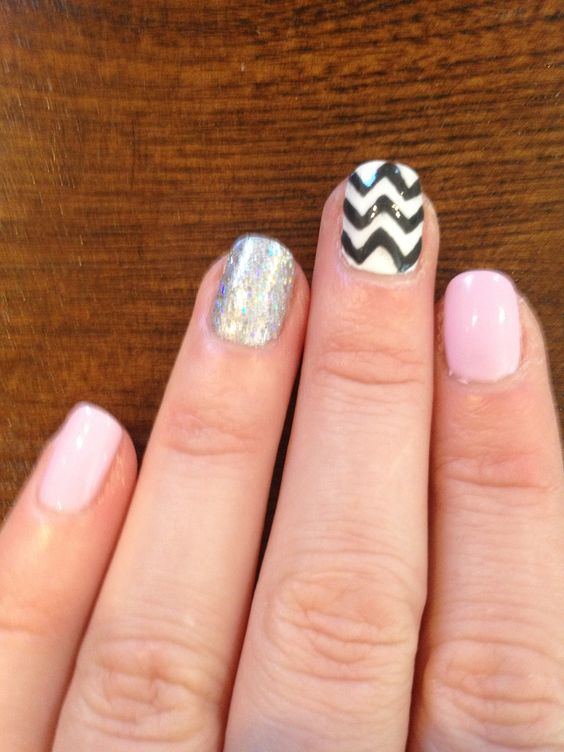 White/gray chevron, silver glitter and pink nails.