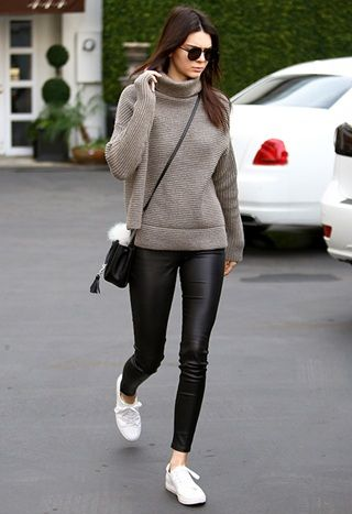 Kendall Jenner wearing jumper and leather look leggings: