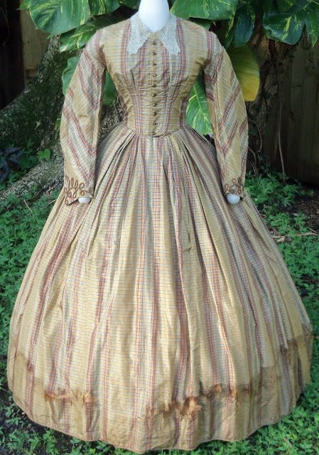 """Plaid silk """"day dress"""" c.1863. Wide Coat-shaped sleeves with cord trim, box…"""