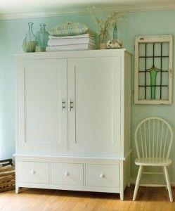 armoire top and i love the stained glass on the wall too!