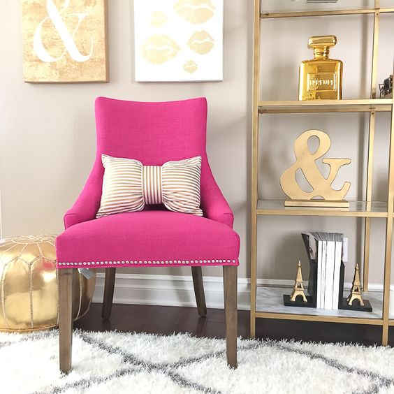 StylishPetite.com | Pink accent chair, gold shelves, striped bow pillow, gold accents - home office decor: