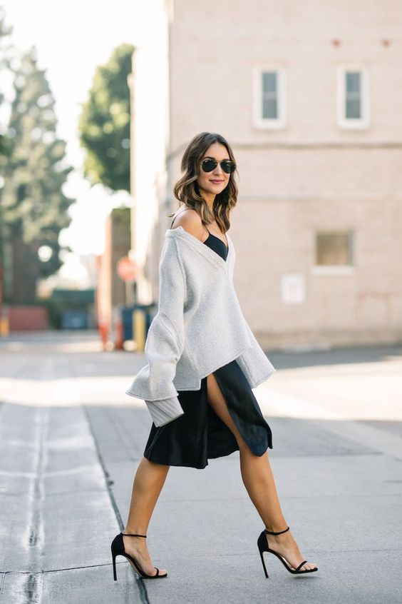 layering a sweater over a slip dress