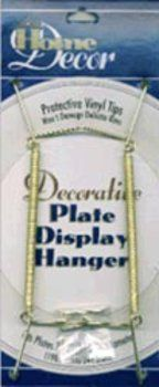 "Darice Decorative Plate Display Hanger Expandable 7-1/2""-9-1/2""-Gold Tone by Darice. $4.16. A gold plate display hanger. Protective vinyl tips will not damage delicate rims. Fits plates 7.5-9/5 in diameter. Holds up to 2 pounds. Brass finish hangers resist tarnishing. For decorative use only. Use only under adult supervision."