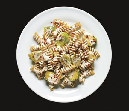 Pasta with roasted Brussels sprouts, goat cheese and oregano