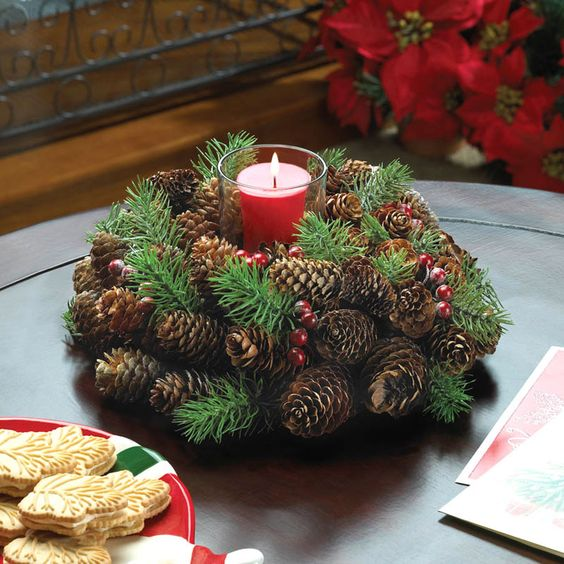 Dress up your holiday table with this merry pine cone wreath candle holder…: