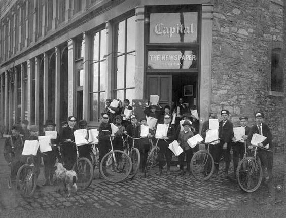 Topeka Daily Capital delivery boys in front of the newspaper's office in Topeka. Date: 1900