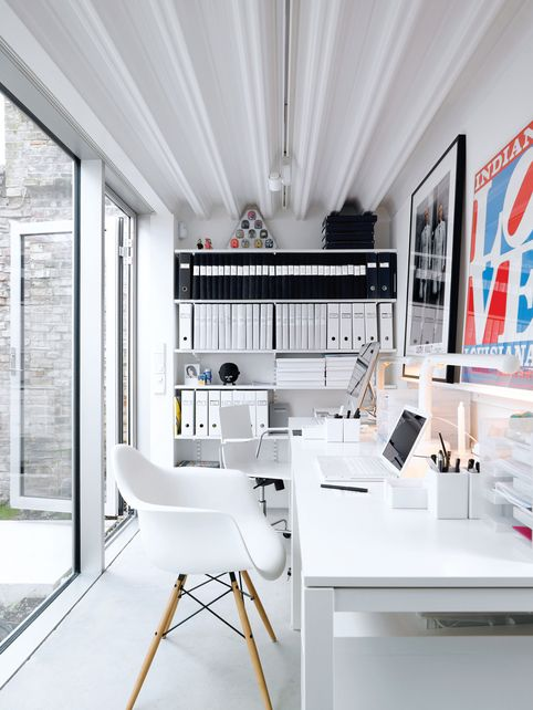 Fantastic white office with colorful art. White desk, white chair, white folders, white walls. #whiteoffice #contemporaryoffice:  office design 10 MODERN HOME OFFICE DESIGN IDEAS a4cd4e27c00550e374c0c0bf83379a78