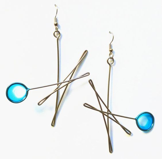 dangle earrings in stainless steel dipped in dyed resin, in blue. Handmade jewelry.