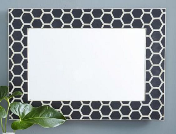 Black and white hexagonal pattern, framed mirror
