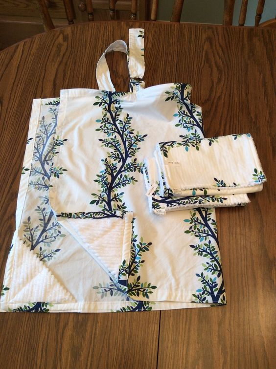 A personal favorite from my Etsy shop https://www.etsy.com/listing/256192754/nursing-cover-2-burp-cloths-set