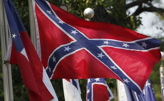 Michigan police officer suspended after driving with Confederate flag at 'Love Trumps Hate' rally