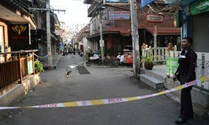 A Thai police officer guards the site in Hua Hin where a small bomb exploded.
