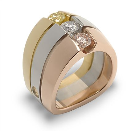 Interlude 150-R48: A trio of Fancy Light Yellow, White and Fancy Light Pink Round Brilliant Cut Diamonds set in 18K Yellow, White and Rose Gold.