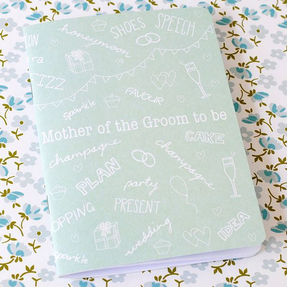 Help the mother of the groom feel involved in the excitement of wedding planning with this handy, handbag-sized notebook.Give the mother of the bride her own notebook by ordering the Mother of the Bride to be Notebook too! the green gables' wedding notebooks range also includes Bride & Bridesmaid Notebook Set, Bridegroom to be Notebook, Best Man to be Notebook and a Flower Girl Notebook.This A6 notebook is the perfect size for the mother of the groom to keep handy in a pocket or handbag,...