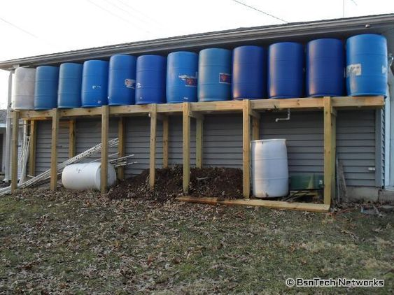 Wow! 660 Gallon Rain Barrel System. A bit big for my needs but the blog has some good info as well.:
